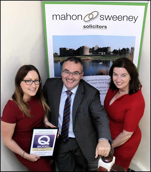 Mahon Sweeney Solicitors holding Q6000 Gold Standard Award